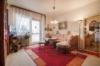 Solide vermietete 2-Zimmerwohnung im grünen Wittenau - Das geräumige Wohnzimmer