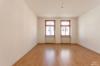 Gepflegtes Mehrfamilienhaus mit sicherer Rendite - Wohnzimmer Wohnung 1