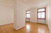 Gepflegtes Mehrfamilienhaus mit sicherer Rendite - Wohnzimmer Wohnung 2