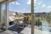 Helle Dachgeschosswohnung mit offenem Wohnbereich und zwei Terrassen - Die Terrasse zum Hof lädt ein!