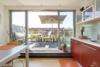 Helle Dachgeschosswohnung mit offenem Wohnbereich und zwei Terrassen - Blick auf die Terrasse