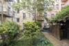 Helle Dachgeschosswohnung mit offenem Wohnbereich und zwei Terrassen - Der schöne Innenhof