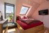 Helle Dachgeschosswohnung mit offenem Wohnbereich und zwei Terrassen - Schlafzimmer an der Terrasse